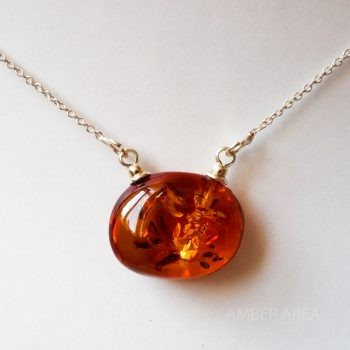 Brown Polished Amber Pendant With A Silver Chain