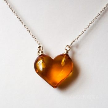 Brown Amber Heart Pendant With A Silver Chain