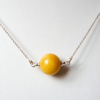 Yellow Round Amber Pendant With A Silver Chain