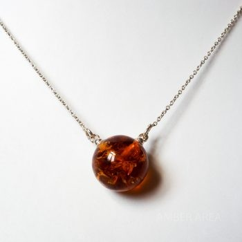 Double Brown Amber Pendant With A Silver Chain