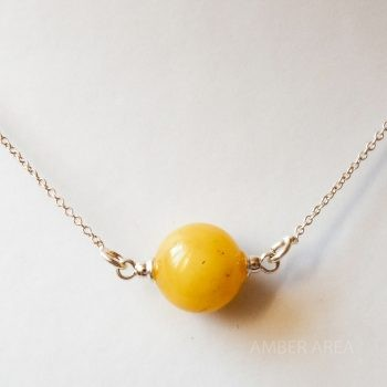 Round Yellow Amber Pendant With A Silver Chain