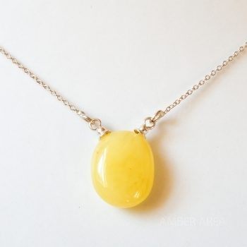 Yellow Amber Pendant With A Silver Chain