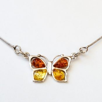 Butterfly Amber Pendant With A Silver Chain
